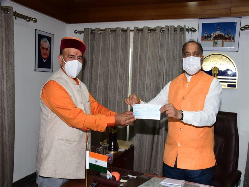 Chief Minister Jai Ram Thakur was presented a cheque of Rs. 25 thousand by Chairman HIMFED Ganesh Dutt of his one month honorarium towards Chief Minister Covid-19