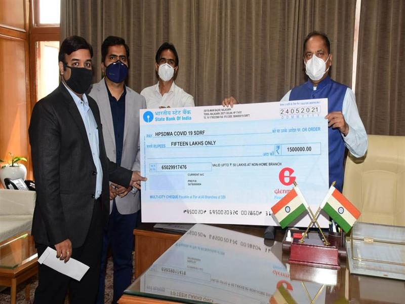 Chief Minister Jai Ram Thakur was presented a cheque of Rs. 15lakh byDinesh Sharma from Glenmark Pharmaceuticals Ltd. Baddi towards Chief Minister