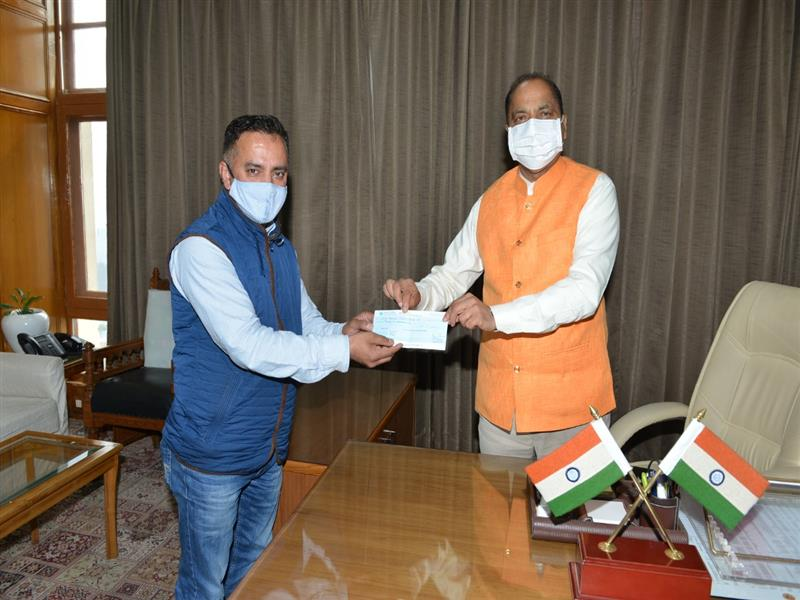 Chief Minister Jai Ram Thakur was presented a cheque of Rs. 21000  by State Vice President  Himachal Pradesh Teachers Confederation Dr. Mamraj Pundir towards Chief Minister Relief