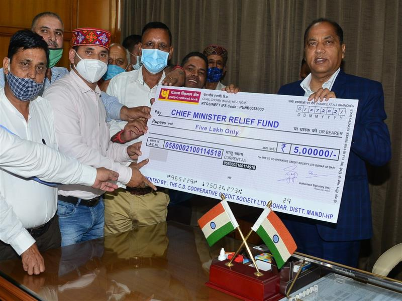 Chief Minister Jai Ram Thakur was presented a cheque of rupees five lakh by Chairman CD Cooperative Society Ltd, Gohar (Dari) Mandi Kamal Rana alongwith BoDs of Society towards